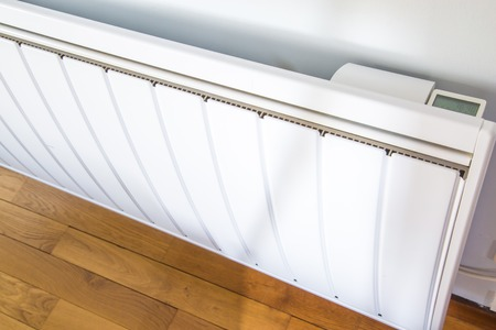temperature controller: High angle closeup of modern radiator with digital temperature Stock Photo