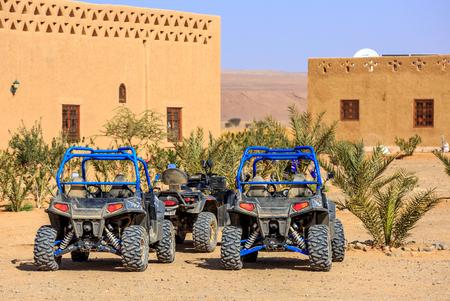 polaris: Itrane, Morocco - Feb 24, 2016: blue Polaris RZR 800 with no pilot parked in a small Berber village in Morocco desert near Merzouga Editorial