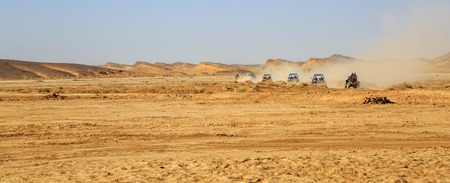 panoramic view on convoys of off road cars with in Morocco desert near Merzouga