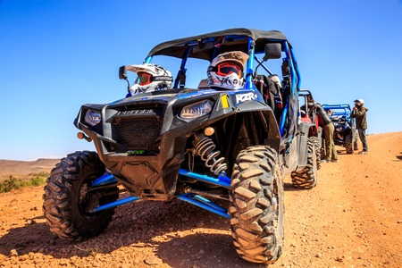 Merzouga, Morocco - Feb 21, 2016: blue Polaris RZR 800 aligned and stationed with no pilot in Morocco desert near Merzouga. Merzouga is famous for its dunes, the highest in Morocco. Editöryel
