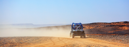off road: panoramic view on off road car with its pilots in Morocco desert near Merzouga Stock Photo