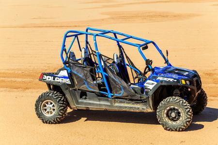 polaris: Merzouga, Morocco - Feb 22, 2016: blue Polaris RZR 800 with no pilot in Morocco desert near Merzouga. Merzouga is famous for its dunes, the highest in Morocco.
