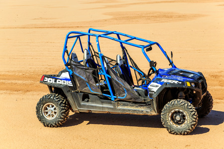 Merzouga, Morocco - Feb 22, 2016: blue Polaris RZR 800 with no pilot in Morocco desert near Merzouga. Merzouga is famous for its dunes, the highest in Morocco.
