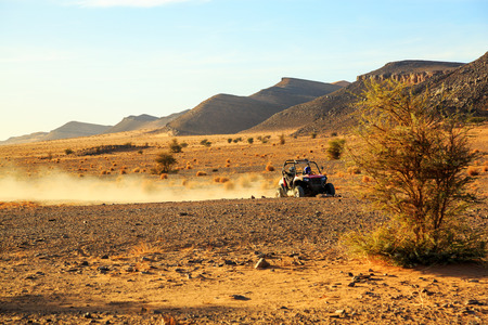 off road car with its pilot in Morocco desert near Merzouga
