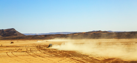 off road: panoramic view on convoys of off road cars with in Morocco desert near Merzouga