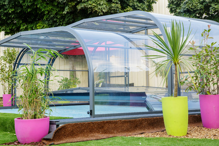 enclosure: La rochelle, France - Aug 30, 2016: automatic retractable pool enclosure system to protect pool