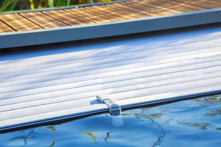closeup on swimming pool roller-shutter covers Banco de Imagens - 67102323