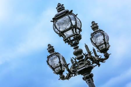 iii: Ornate lamp post along the Pont Alexandre III in Paris