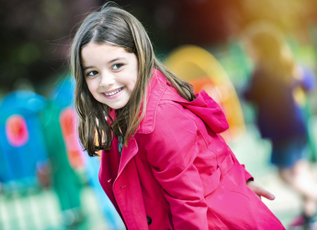 escalation: happy cute little girl in playground