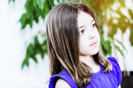 Portrait of cute girl concentrated Stock Photo