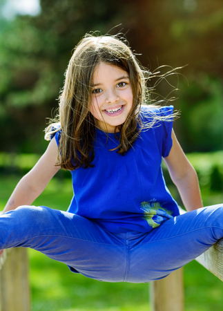 escalation: beautiful portrait of cute child playing with greenery in the background