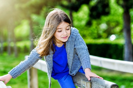 beautiful portrait of a child playing with greenery in the background