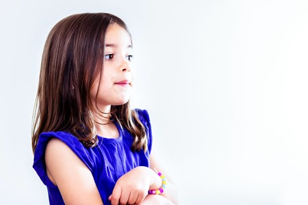 Portrait of cute girl concentrated arms crossed Stock Photo