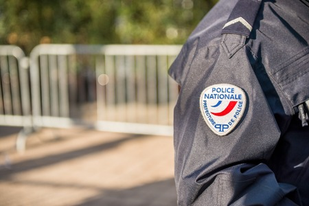 Paris, France - October 26, 2012:Close-up on a French policeman ensuring the safety of the citizens in the street, close view on his badge
