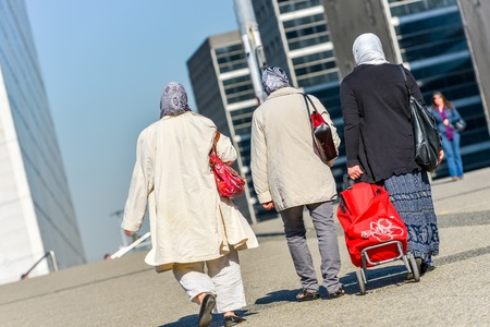 scarves: La defense, France- April 10, 2014: women with chador walking in a street