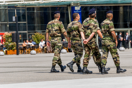 assigned: La defense, France - Mai 12, 2007: French military patrol assigned to the surveillance of a business district near Paris. These troops ensure the safety of the citizens and are there in prevention of the terrorist attacks perpetrated on the French soil