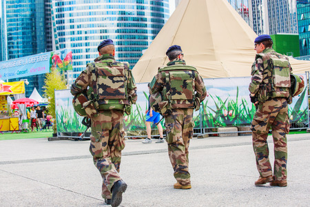patrolling: La defense, France - July 17 2016: French military patrol assigned to the surveillance of a business district near Paris. These troops ensure the safety of the citizens and are there in prevention of the terrorist attacks perpetrated in France Editorial