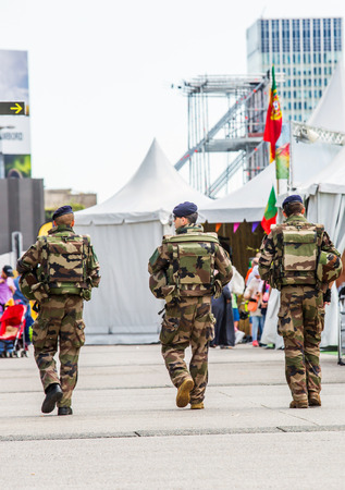 assigned: La defense, France - July 17 2016: French military patrol assigned to the surveillance of a business district near Paris. These troops ensure the safety of the citizens and are there in prevention of the terrorist attacks perpetrated in France Editorial