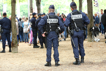 assigned: Paris, France - july 14, 2014: French police patrol (CRS) assigned to the surveillance. These troops ensure the security of the citizens during the parade of July 14 at the entrance of the avenue des champs elysees