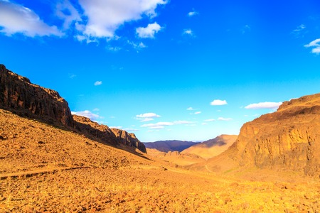 Beautiful Moroccan Mountain landscape in desert with blue sky Stock Photo