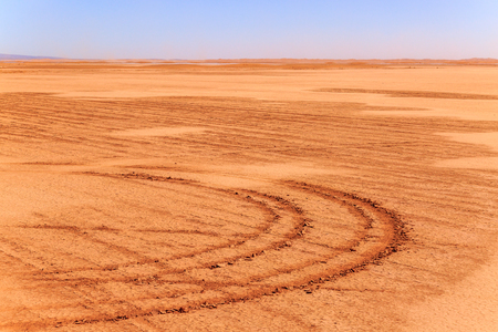 impression: Tire impression on a track in the Moroccan desert