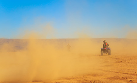 tourists piloting a quad in the Moroccan desert tip