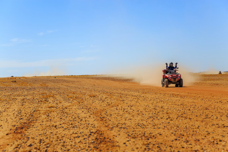 tourist piloting a quad in the Moroccan desert