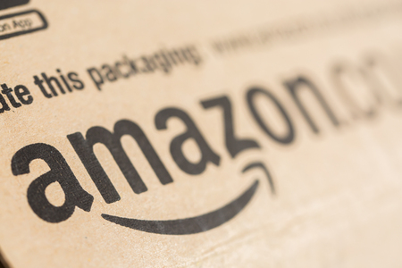 Paris, France - December 15, 2016: Amazon Prime Parcel Package. Amazon, is an American electronic commerce and cloud computing company,based in Seattle, Washington. Started as an online bookstore, Amazon is become the most importrant retailer in the Unite Éditoriale