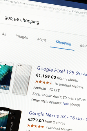adwords: Paris, France - January 03, 2017 : Close up of Google Shopping main page on a computer screen. Google Shopping is a service offered by Google to compare prices of different products.
