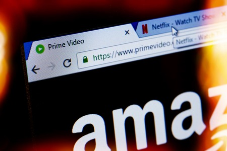 signup: Paris, France - December 15, 2016: Amazon Prime Video VS Netflix concept. HomePage of Website.Two tabs showing the home pages of leader companies offering video-on-demand services competitors Netflix and Amazon prime video. focus on Amazon Prime Video hom