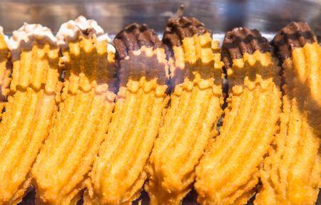 teaparty: Fresh spanish churros in a shop Stock Photo
