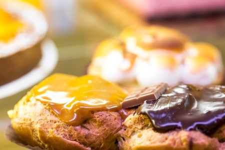 choux bun: Traditional French Dessert with Dark Chocolate and Caramel