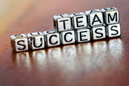 team success business letters on arrange small metal pieces