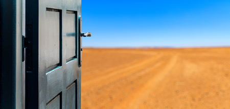 Opened door concept to beautiful and imaginary desert landscape