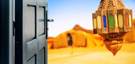 dream land: Opened door concept to beautiful berber camp on desert Stock Photo