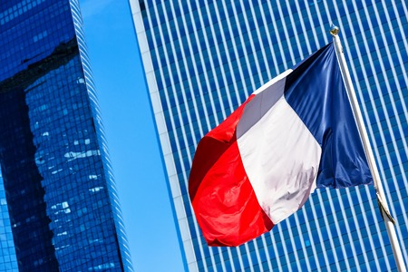 French flag with business building on background Banco de Imagens