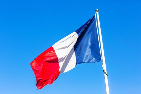 French flag under blue sky