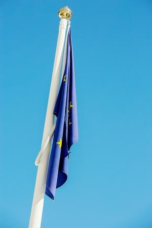 flag at half-mast illustrating a fall of european union