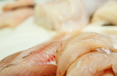 fresh Fish fillets on showcase of seafood market