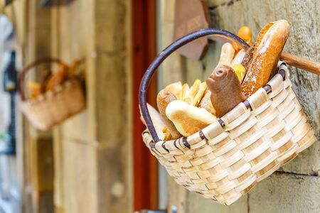 seeds of various: Fresh bread in the basket in front a bakery shop