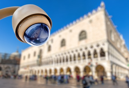 security CCTV camera with touristic site on blurry background