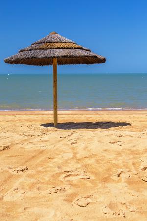 straw beach umbrella with blue sky Stock Photo