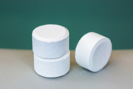 br: tablet of chlorine or bromide for mainteance of water quality of jacuzzi or spa Stock Photo
