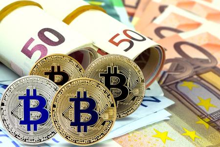 Bitcoin (virtual coins) on euros banknotes. Closeup, macro shot