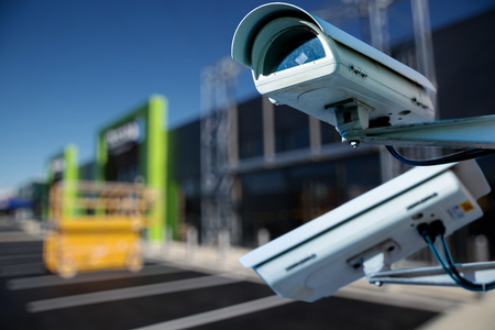 security CCTV camera or surveillance system with construction site on blurry background