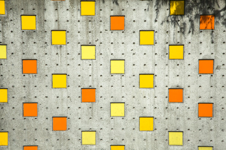 Square colorful background in orange, yellow on street wall