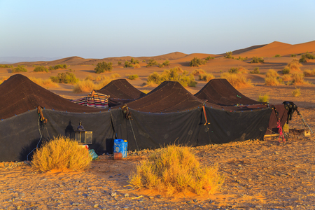 Merzouga, Morocco - February 25, 2016: Moroccan Sahara Desert Camp with the Sahara Desert in the background. Merzouga is famous for its dunes, the highest in Morocco.