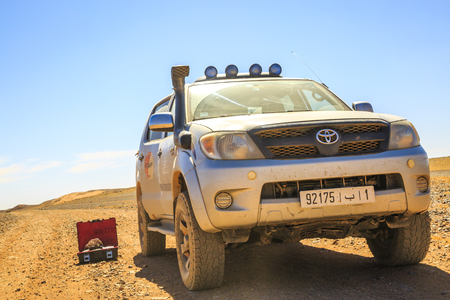Ait Saoun, Morocco - February 23, 2016: Stationary Toyota Hilux with tool box besides in the middle of Ait Saoun desert of Morocco.