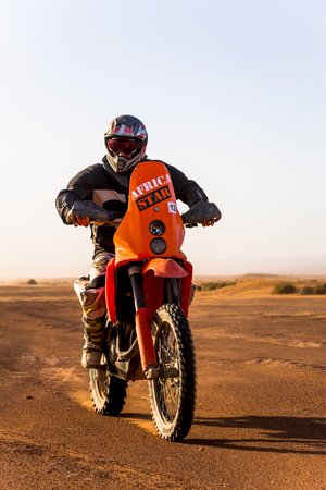 Ait Saoun, Morocco - February 22, 2016: Unidentified racer on a motorcycle in Moroccon desert, Ait Saoun.