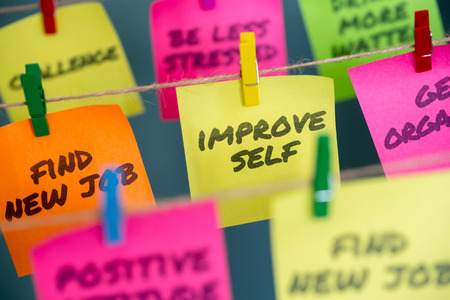Sticky notes with hanging on jute rope clipped with improve self written on it Stock fotó